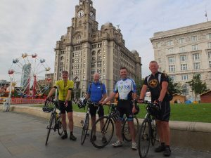Dr Webster rode 500 miles for Woolton Community Life. Picture here with Mal Bishop. Dr Mark Wiggleswort and Dr Jason Kirby.